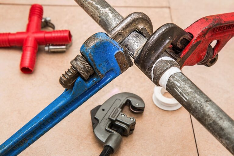 Wrenches being used on household piping