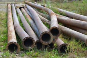 Sewer pipes laying on grass