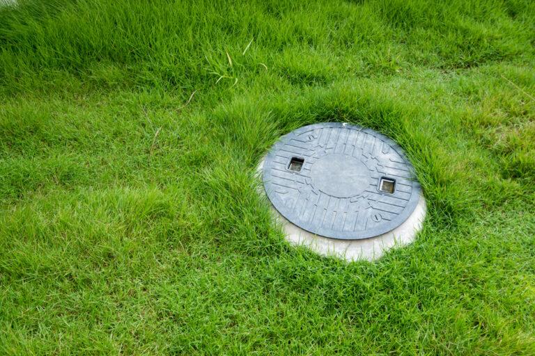 sewer in grassy field